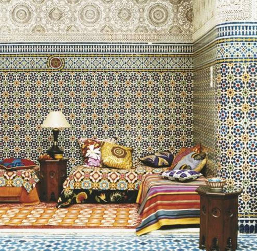 Moroccan-exotic-decoration-with-small-wooden-tables-and-cushions-with-fabrics